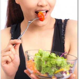 Pretty girl eating healthy food